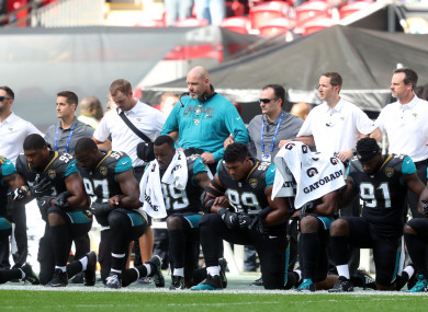 Jacksonville Jaguars players kneel in protest during the national anthem.