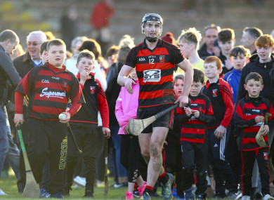 Ballygunner's Pauric Mahony is surrounded by supporters at the end of the game.