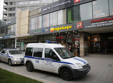 Police vehicles parked outside a building where the Ekho Moskvy radio station is located