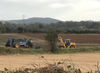 Farm equipment spreading the treated sludge on the land in January.