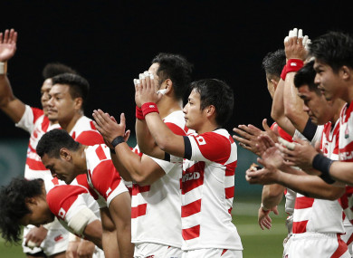 Japan's rugby team greets supporters at the end of their rugby union international match against France at the U Arena.