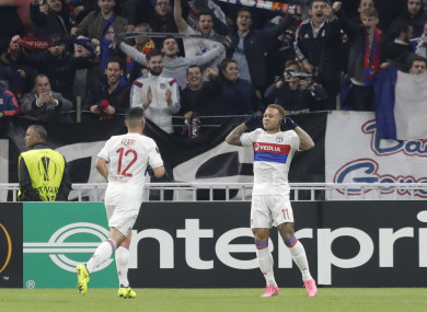 Lyon's Memphis Depay (right) celebrates with team-mate Jordan Ferri.