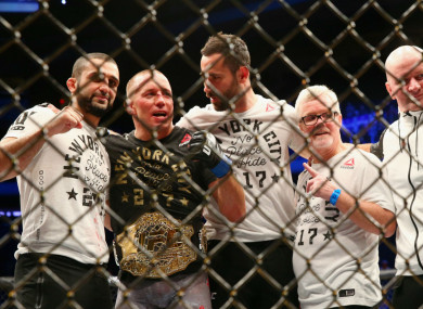 Georges St-Pierre celebrates UFC 217 win over Michael Bisping