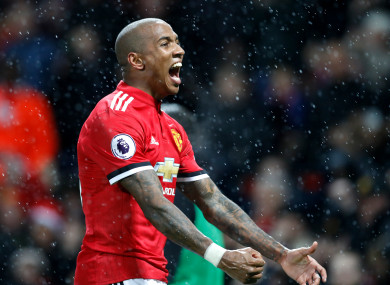 Ashley Young celebrates.