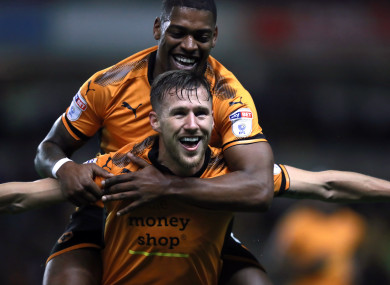 Wolverhampton Wanderers' Barry Douglas (bottom) celebrates scoring his side's first goal.
