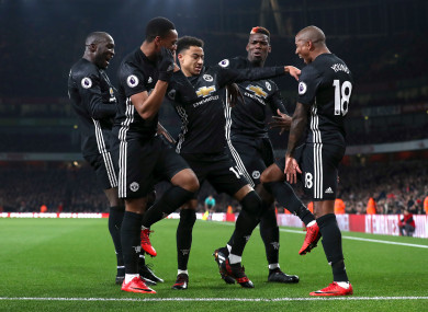The United players celebrate one of Lingard's two goals.
