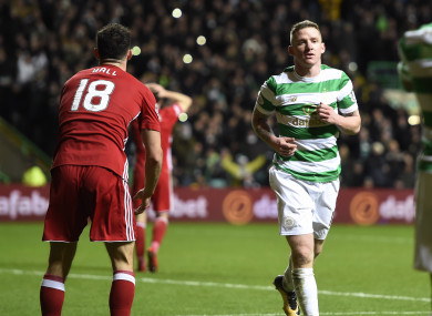 Jonny Hayes (centre) celebrates after scoring the second goal during the Scottish Premiership match at Celtic Park.