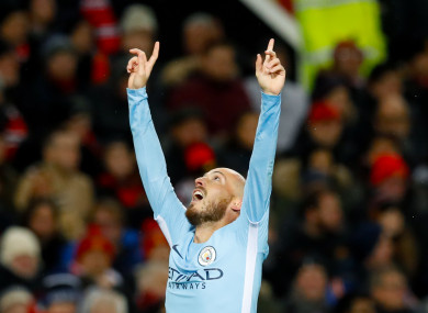 Manchester City's David Silva celebrates scoring his side's first goal of the game during the Premier League match at Old Trafford.