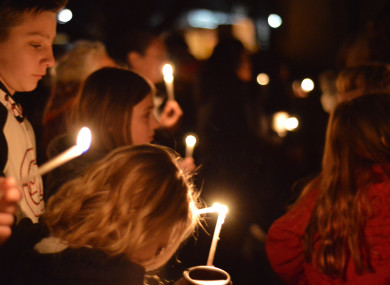 Aztec High School students and area residents gather for a candlelight vigil.
