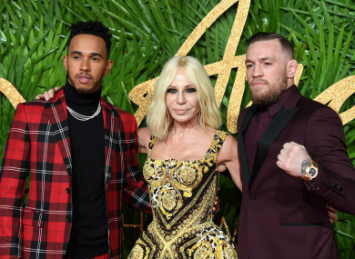 Conor McGregor with Lewis Hamilton and Donatella Versace at the 2017 Fashion Awards in London this week.
