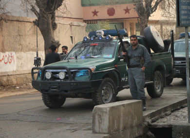 Afghan security force members arrive at the site of an attack in Jalalabad city, Afghanistan