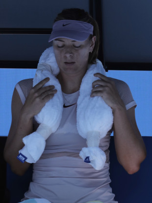 Russia's Maria Sharapova uses a cool towel during a break while playing Latvia's Anastasija Sevastova during their second round match at the Australian Open tennis championships in Melbourne.