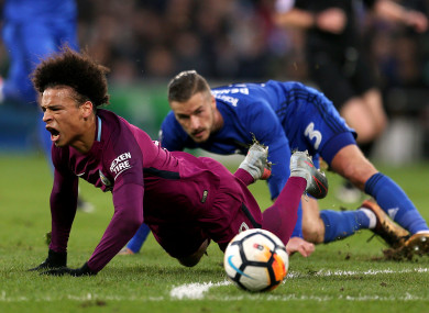 Manchester City's Leroy Sane after being tackled by Cardiff City's Joe Bennett.