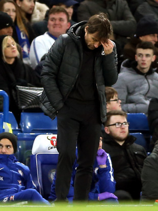 Chelsea manager Antonio Conte appears dejected on the touchline.