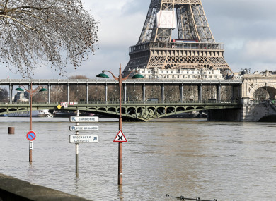 A flooded bank of the Seine in front of the Eiffel tower in Paris yesterday.