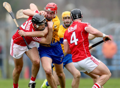 Cork pair Christopher Joyce and Colm Spillane  with Peter Duggan of Clare.
