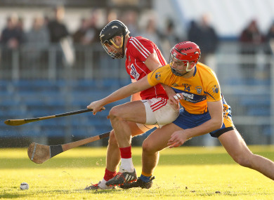 Cork's Eoin Cadogan and Clare's Peter Duggan in action earlier this year.
