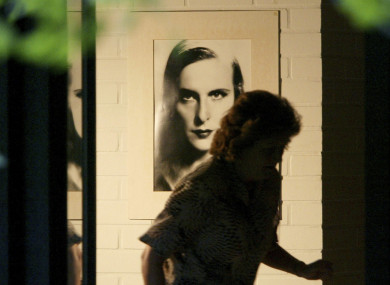 A housekeeper, who refused to be identified, passes by a picture of famous film director Leni Riefenstahl on the wall in Riefenstahl's home in Poecking, south of Munich, on Tuesday, Sept. 9, 2003.
