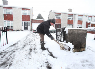 Local man clearing out his driveway in Glasnevin.