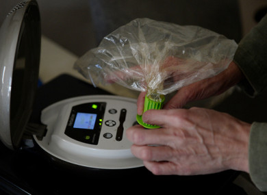 File photo: A different medical marijuana patient, uses a Herbalizer to fill a bag with cannabinoid vapor to manage chronic fibromyalgia in the US