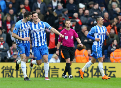 Shane Duffy (left) celebrates with Brighton goalscorer Lewis Dunk.