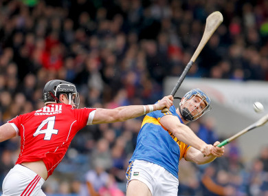 Jason Forde hits a point despite pressure from Colm Spillane.