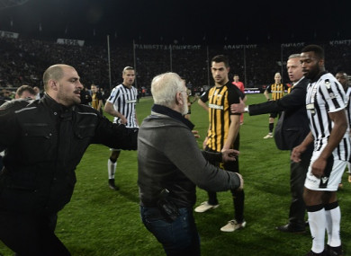 Ivan Savvidis, seen here with a handgun in his waistband, invaded the pitch after his side's defeat to AEK Athens.