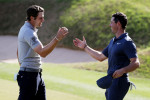 McIlroy (right) and Peter Uihlein shake.
