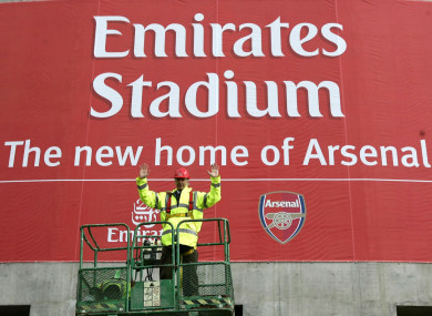 Arsene Wenger visits the Emirates Stadium during its construction.
