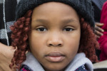 Yvonne Tshala, six, who has been living in a Direct Provision centre in Cork with her mother for over three years, pictured at a demonstration calling for the end of DP (November 2017)