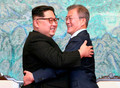 North Korean leader Kim Jong Un, left, and South Korean President Moon Jae-in embrace each other after signing on a joint statement at the border village of Panmunjom in the Demilitarized Zone.