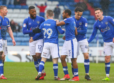 Byrne (centre) celebrates his goal with his Oldham team-mates.