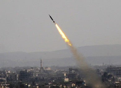 A rocket is seen launched by the Syrian army in Eastern Ghouta countryside of Damascus, Syria, two days ago.