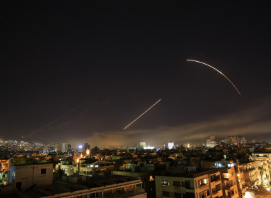 Missiles streak across the Damascus skyline early Saturday.