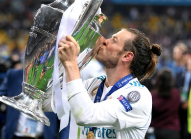 Gareth Bale celebrates with the Champions League trophy.