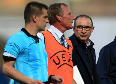 Martin O'Neill speaking to referee Zbynek Proske after Ireland's defeat to the Netherlands in the European U17 Championship quarter-finals.