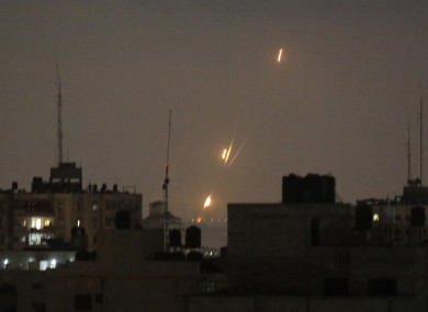 Flames of rockets fired by Palestinian militants are seen over Gaza Strip toward Israeli lands.