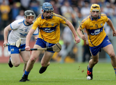 Clare's Jack Minogue and Mark Rodgers with Sean Henley of Waterford.