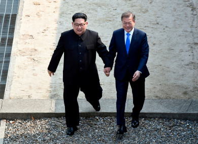 The leaders of North and South Korea hold hands as they meet for an historic summit last week.