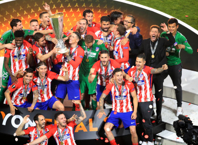 Fernando Torres lifts the trophy with his Atleti team-mates.