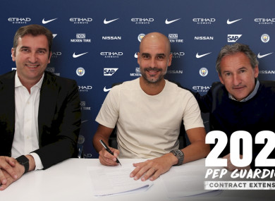 Pep signs his contract extension.