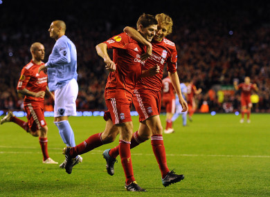 Gerrard and Lucas celebrate a goal back when they were teammates at Liverpool