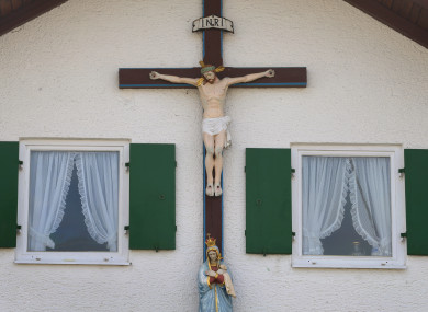 A large crucifix on a wall of a house in Germany