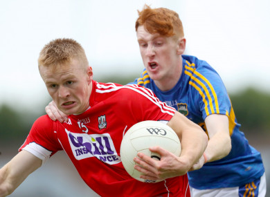 Cork's Damien Gore with Eanna McBride of Tipperary.