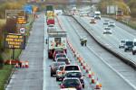 PSNI detectives investigating the murder of prison officer David Black revisit the scene of the killing on the M1 motorway in November 2012.