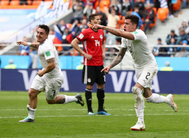 José Giménez celebrates giving Uruguay the lead at the Ekaterinburg Arena.