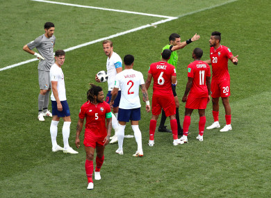 England's Harry Kane steps up to take his second penalty as Panama players speak with referee Gehad Grisha.