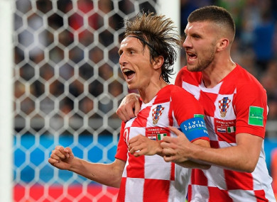 Modric celebrates alongside team-mate Ante Rebic on Saturday.