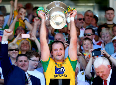 Donegal captain Michael Murphy lifts the cup.