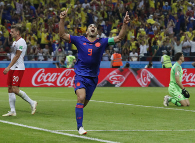 Colombia's Radamel Falcao, centre, celebrates after scoring.